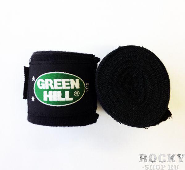 Бинт боксерский, эластичный, 3.5 метра, 3,5м Green HillБоксерские бинты<br>Материал: Хлопок - ПолиэстерВиды спорта: БоксБинт боксерский Green Hill, сделан из хлопка с добавлением эластика, растягивается, обеспечивает плотное стягивание кистей рук, крепиться на липучке. Боксерский бинт используется для бинтования кистей рук, для предотвращения травм суставов пальцев, обеспечивается такая защита путем плотного стягивания пальцев бинтом друг к другу, что создает единую площадь удара и способствует распределению нагрузки, так же бинт полезен во время тренировок, впитывая пот ладоней, не давая загрязняться внутренней части перчаток. <br> Изготовлен из полиэстера и хлопка<br> Петля для большого пальца<br> Липучка для фиксация<br><br>Цвет: Черный