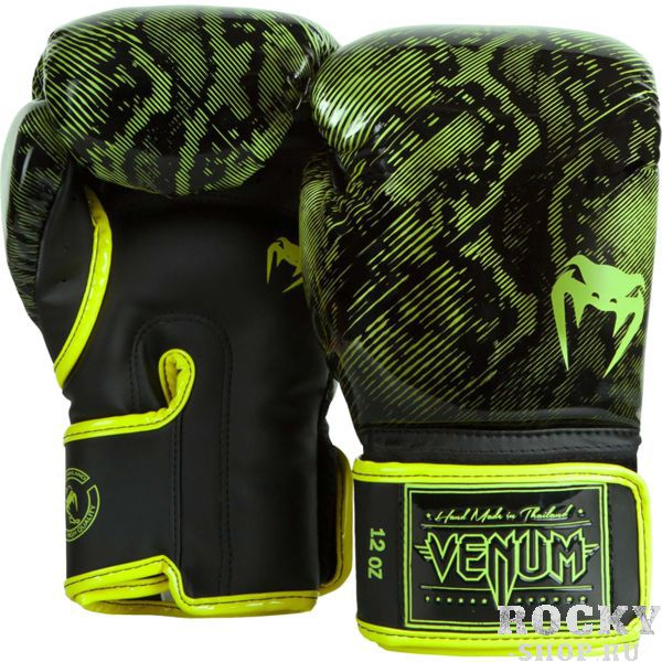 Перчатки боксерские Venum Fusion Yellow, 14 oz VenumБоксерские перчатки<br>Боксерские перчатки Venum Fusion. Классические перчатки для бокса, муай тай, ММА, для работы в парах и на мешках. очень хорошо сидят на руке. Широкая застежка обеспечивает надежную фиксацию перчаток Venum на запястье. Внутренний наполнитель - пена, которая обеспечивает хорошую амортизацию удара, а значит и обеспечивает хорошую защиту рук. Внешняя часть перчаток выполнена из материала Skintex Leather. Этот современный материал имеет аналогичные характеристики натуральной кожи, но делает их производство дешевле. Очень качественно сделанные швы. Сделано в Тайланде.<br>