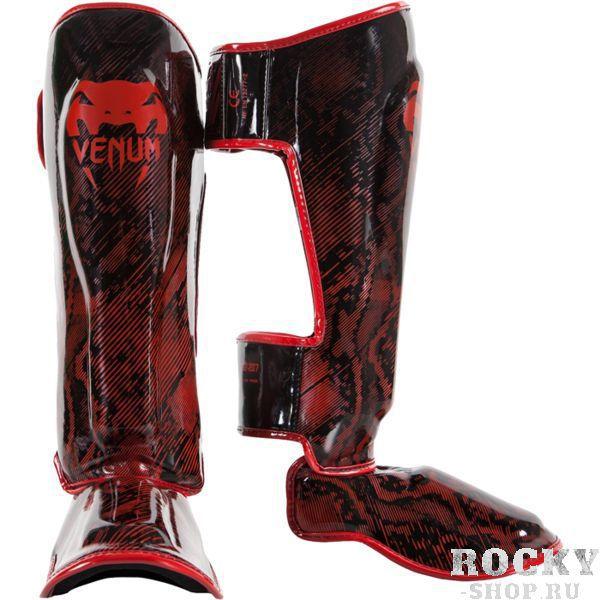 Защита голени Venum Fusion, Красная VenumЗащита тела<br>Тайские шингарды (накладки на ноги) Venum Fusion. Данный вид шингард предназначен для особо сильной работы ногами, поэтому они пользуются популярностью у бойцов тайского бокса и K-1. Накладки Venum - идеальное сочетание качества, стиля и комфорта. Шингарды надежно защищают и голень, и стопу! Наполнитель: пена, снижающая силу удара. Внешняя обивка: Semi Leather! Все швы тщательно укреплены. Внутренняя обивка: приятная ткань. Великолепно облегают ногу не создавая какого-либо дискомфорт бойцу. Крепятся с помощью двух ремней-липучек. Сделано в Тайланде, ручная работа! Продаются парой. Данная модель не допускается к оптовой продаже.<br><br>Размер: L
