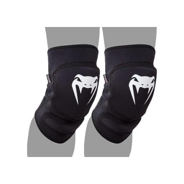 Наколенники Venum Kontact Evo Knee Pads - Black VenumЗащита тела<br>Наколенники Venum Kontact Evo Knee Pads - Black имеют наполнитель пены высокой плотности для улучшенной амортизации. Ваше колено будет выдерживать больше ударов, защищено от ушибов и ссадин. Теперь Вы не будете отвлекаться на проблемы связанные с коленом, а будете сосредоточены только на боевой игре. Имеют анатомическую форму. Ультра-легкий, гладкие и гибкие - гарантируют неограниченный диапазон движений. Сетка на задней поверхности обеспечивает хорошую вентиляцию и комфорт. Сделано в КитаеСостав: неопрен 100%<br><br>Размер: M/L