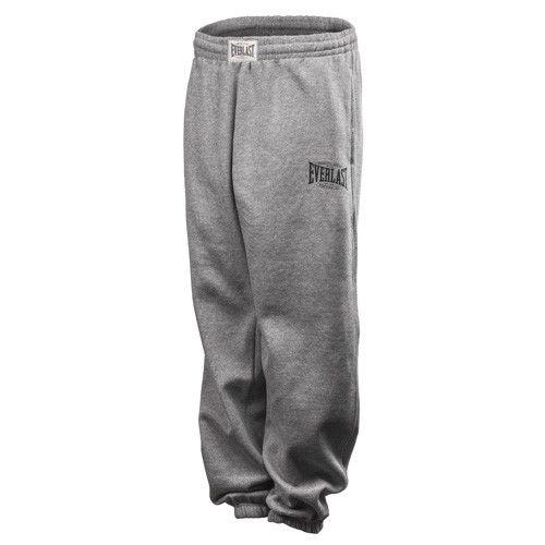 Спортивные брюки Everlast Authentic, Серые EverlastСпортивные штаны и шорты<br>Эластичный пояс с внутренним шнурком.Эластичные манжеты для щиколоток.Внутри отделаны мягким флисом.На ноге логотип Everlast.Состав серой модели: 70 % хлопок,30 % полиэстер.Возможна машинная стирка.<br>