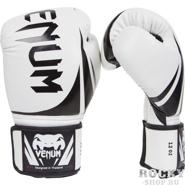 Перчатки боксерские Venum Challenger White, 8 унций VenumБоксерские перчатки<br>Перчатки боксерские Venum Challenger White - доступные, но без ущерба качеству, боксерские перчатки Venum Challenger 2. 0, разработанные в Тайланде - идеальный выбор для обучения ударной технике!Благодаря тройному слою пены и широкому ремню, достигается оптимальная степень защиты. Состоят из премиумной полиуретановой кожи (PU) - очень прочные и по отличной цене!Особенности:Из высококачественнойсинтетической кожиТройная плотность пены, для лучшей защиты. 100% полное прилегание большого пальца. Большая упругая липучка для лучшей фиксацииРельефный логотип VenumСделано в Тайланде<br>