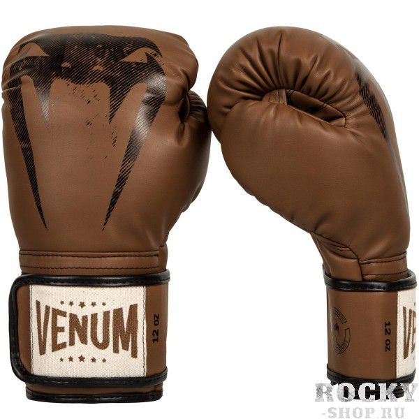 Перчатки боксерские Venum Giant Sparring Brown, 10 oz VenumБоксерские перчатки<br>Перчатки боксерские Venum Giant Sparring Brown созданы с оттенком винтажного классического стиля - единственные в своем роде.Доработаны для увеличения степени защиты рук, в особенности фаланг пальцев.Многослойная высокоплотная пена гарантирует равномерное поглощение удара. Манжета на липучке гарантирует твердую поддержку запястья, предотвращая любые повреждения во время боя.Эти перчатки в своих тренировках использует мировая звезда муай-тайSitthichai Sitsongpeenong - номер 1 в рейтинге Glory в легком весе.С кем бы Вы не тренировались, безопасность при любых ударах обеспечена.Высокое качество кожи Semi продлевает их срок службы в сравнении с обычными материалами.Особенности:- высокоплотная многослойная пена- защита большого пальца- ручная работа, Тайланд<br>
