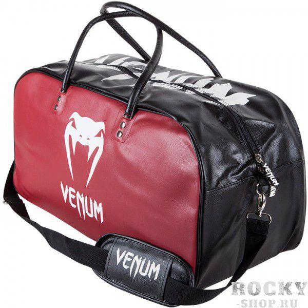 Сумка Venum Origins Bag Medium Black/Red VenumСпортивные сумки и рюкзаки<br>Сумка Venum Origins Bag Medium Black/Red - отличный аксессуар для перемещения вещей по любому виду спорта. Сделана из синтетической кожи Skintex. Молния надежно защищает содержимое, а двойные ручки очень комфортны в использовании. Особенности:- размер&amp;nbsp;55cм x 25cм x 25cм<br>