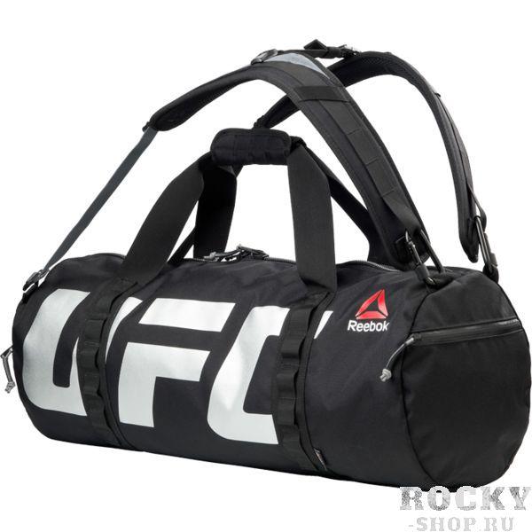 Сумка-рюкзак Reebok UFC ReebokСпортивные сумки и рюкзаки<br>Сумка-рюкзак Reebok UFC Fan. Эта прочная сумка из коллекции Reebok-UFC с успехом вместит в себя все необходимое. Вставки из суперпрочной ткани Cordura гарантируют долговечность, функциональный дизайн позволяет носить ее как за плечами, так и на одном плече, а многочисленные карманы вместят все нужные вам предметы экипировки. Съемные двойные регулируемые ремни позволяют носить сумку как за плечами, так и на одном плече. Сетчатое отделение на молнии для вентиляции. Металлический карабин отлично подходит для еще одной сумки или бутылки с водой. Логотип UFC сбоку позволит продемонстрировать серьезность намерений. Язычок с логотипом Reebok знак твоей приверженности бренду. Габариты: 63 х 28 х 28. Материал: 100% полиэстер CORDURA.<br>