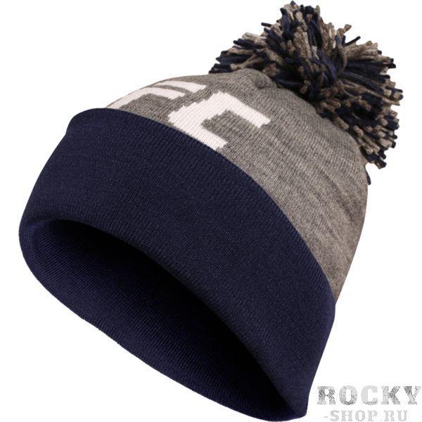 Шапка Reebok UFC ReebokШапки<br>Шапка Reebok UFC. Тёплая и стильная зимняя шапка с помпоном. Размер - универсальный. Состав: акрил.<br>