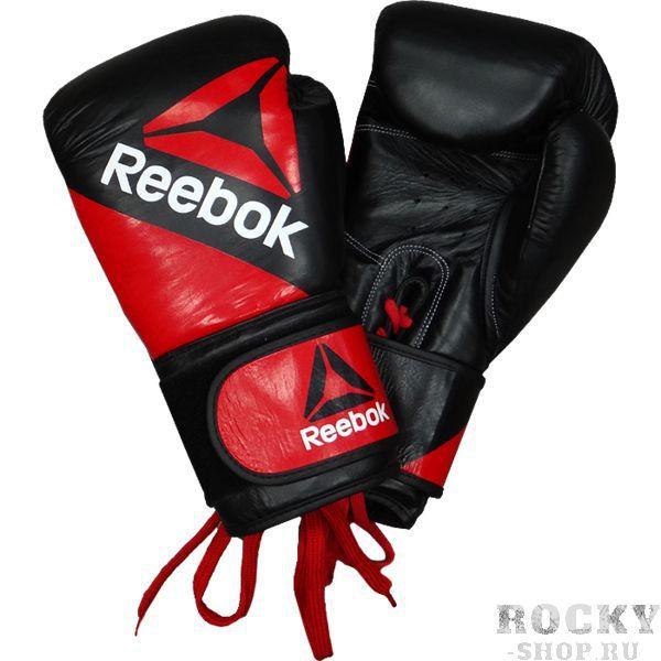 Боксерские перчатки Reebok, 14 oz ReebokБоксерские перчатки<br>Боксерские перчатки Reebok. Обеспечивают своему владельцу наивысшую защиту. Данные перчатки для бокса идеально садятся на кулак боксера и на редкость приятны на ощупь внутри. Перчатки сшиты вручную из натуральной кожи. Дизайн, удобство и функциональность - вот основные достоинства этих перчаток. Классическая шнуровка говорит о профессиональных качествах этого продукта ивнимании к защите запястья бойца.<br>