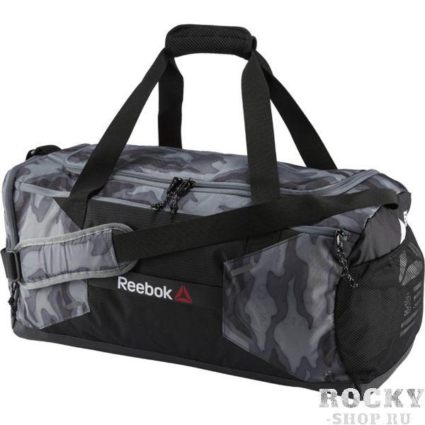 Сумка Reebok ONE ReebokСпортивные сумки и рюкзаки<br>Сумка Reebok ONE Series Unisex. Отделение для влажной экипировки спереди. Регулируемый плечевой ремень для надежной посадки. Ручки с сетчатой прокладкой для лучшей вентиляции. Сетчатые карманы по бокам. Отделение для обуви на молнии с перфорациями для вентиляции. Габариты: 53 х 27 х 46, объем 48 л. Материал: 100% полиэстер.<br>