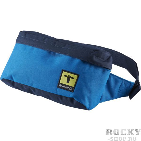 Поясная сумка Reebok Motion ReebokСпортивные сумки и рюкзаки<br>Поясная сумка Reebok Motion Workout. Регулируемый ремень для функциональности. Карман на молнии спереди отлично подходит для хранения мелочей. Внутренне отделение на подкладке из легко чистящегося материла. Габариты: 28 х 14 х 8. Материал: 100% полиэстер.<br>