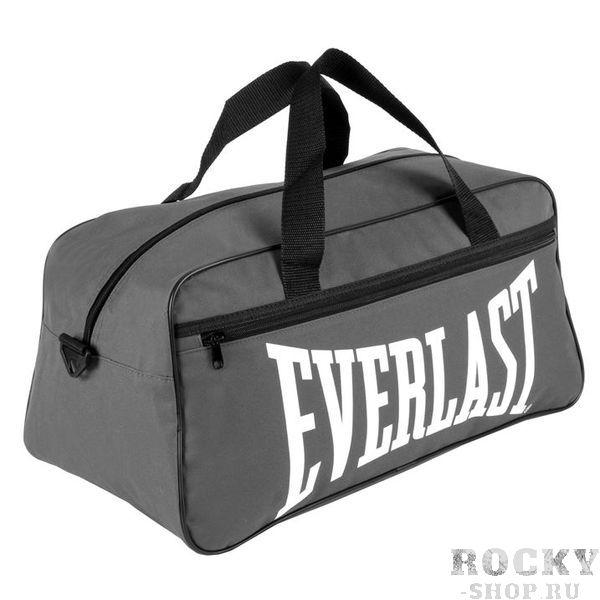 Спортивная сумка Everlast Holdall Grey EverlastСпортивные сумки и рюкзаки<br>Спортивная сумка Everlast Holdall GreyРекомендуем эту модель для тех, кто собирается в путешествие или на тренировку. Если вы не любите громоздкие рюкзаки  и чемоданы, то  такая сумка подойдет для вас идеально. Плотный материал, крепкие ручки, внешний карман. Можно носить через плечо. Длина 52 см, высота 24 см, ширина 25 см.Состав:100%- полиэстер.<br>