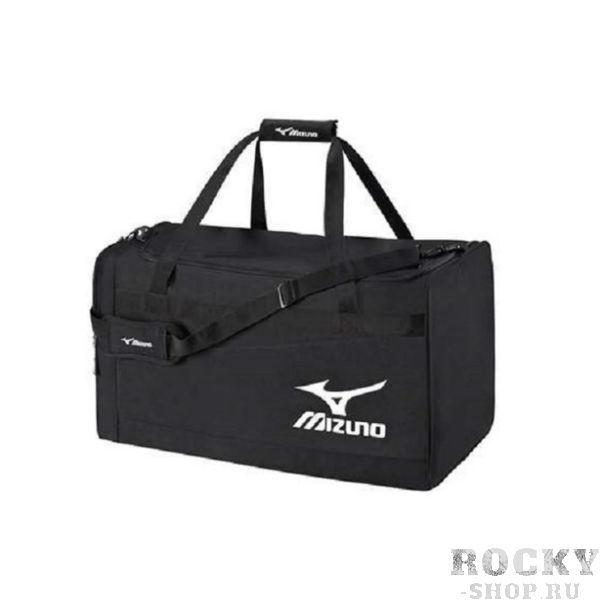 MIZUNO K3EY6A07 90 TEAM HOLDALL MEDIUM Сумка MizunoСпортивные сумки и рюкзаки<br>Сумка MIZUNO K3EY6A07 90 TEAM HOLDALL MEDIUM•Вместительная спортивная сумка среднего размера изготовлена из 100% полиэстера. •Основное отделение закрывается широкой крышкой на молнии с двумя бегунками для полного доступа к вещам. •Материал водонепроницаем, но при этом отлично пропускает воздух. •Пара ручек для переноски в руках и регулируемый ремень через плечо для удобства пользования. •Вентилируемый боковой карман позволяет хранить влажные вещи или обувь. •Размер (Д х Ш х В): 61 х 28 х 32 см.<br>