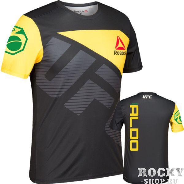 Футболка Reebok UFC Jose Aldo ReebokФутболки<br>Спортивная футболка Reebok UFC Jose Aldo Jersey. Официальная футболка легендарного бойца Жозе Альдо от Reebok UFC. Благодаря плоским швам и прочному легкому материалу она отлично подходит как для тренировок, так и для повседневной жизни. Состав: 100% полиэстер.<br><br>Размер INT: XXL