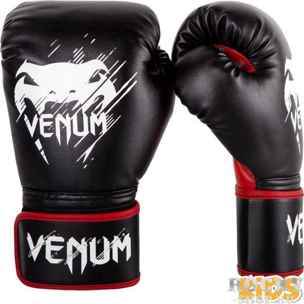 Детские перчатки Venum Contender, 6 oz VenumБоксерские перчатки<br>Детские боксерские перчатки Venum Contender. Классические детские перчатки для бокса, муай тай, ММА, для работы в парах и на мешках. очень хорошо сидят на руке. Широкая застежка обеспечивает надежную фиксацию перчаток Venum на запястье. Внутренний наполнитель - пена, которая обеспечивает хорошую амортизацию удара, а значит и обеспечивает хорошую защиту рук. Внешняя часть перчаток выполнена из материала Skintex Leather. Этот современный материал имеет аналогичные характеристики натуральной кожи, но делает их производство дешевле. Очень качественно сделанные швы.<br>