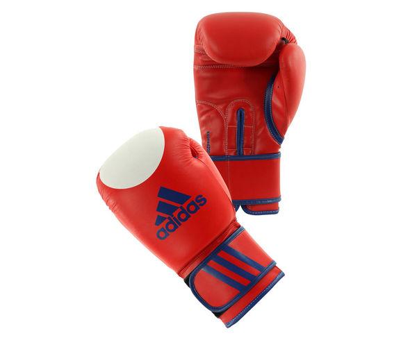 Перчатки для кикбоксинга Kspeed200 WAKO, 10 унций AdidasБоксерские перчатки<br>Перчатки для кикбоксинга adidas Ultima Target WACO,боксерские перчатки изготовлены из PU3GINNOVATION- это материал, который выглядит, как кожа, мягкая и прочная, и нечувствителен к колебаниям температуры и влажности. Перчатки имеют отверстия на ладони, которые обеспечивает циркуляцию воздуха и влаги внутри перчатки и она быстро сохнет и остается свежей и таким образом имеет более длительный срок службы. Перчатки боксерскиеUltima Target WACOс технологией I-Protech ®- это композитный литой вкладыш из пены высокого давления IMF (Intelligent MouldFoamTechnology), который обеспечивает однородный уровень поглощения удара,что гарантирует идеальную защиту для ваших рук, а также безопасно для вашего партнера по тренировкам. У перчатки специальная усиленная манжета, шириной 7. 5 см. сувеличенной жесткостьюс технологией Softpunch ®, обезопасит иисключит риск получения травм кисти. Манжета с ремешком налипучке, для быстрой регулировки боксерских перчаток. Одобрено WAКO(ВсемирнаяФедерацияКикбоксинга). Состав: 100% полиуретан. Тренировочные боксерские перчатки на липучке. Полиуретан по технологии PU3G INNOVATION®. Композитный литой вкладыш из пены высокого давления по технологииI-Protech ®. Усиленная защита большого пальца, ладони. Широкая, жесткая манжета. Специально удлиненная модель перчатки(adiBT02), для защиты от ударов ног. Одобрено WAКO(ВсемирнаяФедерацияКикбоксинга) 100% полиуретан.<br><br>Цвет: красные