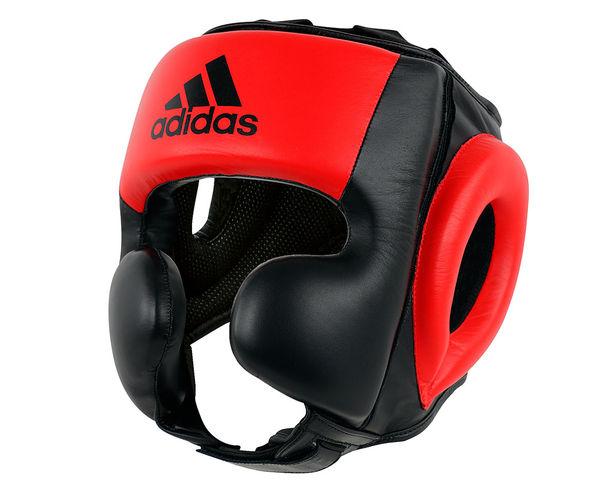Шлем боксерский Pro Sparring Headguard черно-красный AdidasБоксерские шлемы<br>Профессиональный тренировочный шлем adidasPRO SPARRING HEADGUARD ЧЕРНО-КРАСНЫЙ- предназначен как для любителей, так и для профессионального применения с сочетанием высочайшего качества, защиты и долговечностью. Шлем изготовлен из высококачественной воловьей кожи. Так же в шлеме используется технологию I-PROTECH®, которая характеризуется особой конструкцией EVA-пены внутри шлема, она дополнительно поглощать удары и вибрации, проходящие на голову спортсмена. ШлемPRO SPARRING HEADGUARDимеет улучшенную, защиту скул, что обеспечивает, более эффективную защиту лица. С внутренней стороны используется материал Amara по технологии Coldwave, обладающий высокой износоустойчивостью - намного продлевает срок службы изделия, а также является более дышащем материалом. Шлем защищает голову, скулы,подбородок, уши. Он предназначен для тех, кто профессионально занимается боксом, а так же для спортсменов других видов контактного спорта, где необходима совершенная,проверенная, профессиональная защита.   Высококачественная воловья кожа.  Улучшенная, защита лица.  ТехнологияI-PROTECH®  Повышеннаяизносоустойчивость материала  Антиаллергенные и антискользящие свойства подкладки.<br><br>Размер: L
