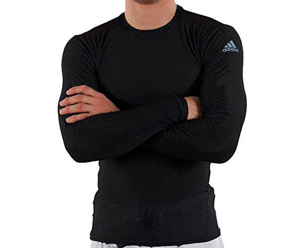 Футболка компрессионная (Рашгард) Rush Guard Long Sleeve, черная AdidasРашгарды<br>Рашгард с длинным рукавом, обеспечивает защиту от микротравм (ссадин, ожогом в мат), удобно сидит, практически не ощущаете его на теле как вторая кожа благодаря этому тело не остывает, что позволяет предотвращать мелкие травмы. Специальный материал обеспечивает циркуляцию воздуха, рашгард быстро сушится и достаточно прочный. Взято на вооружение многими видами единоборств!100% полиэстер&amp;nbsp;Прочный материалВставки на спине для выведения влаги.<br><br>Размер INT: 2XL