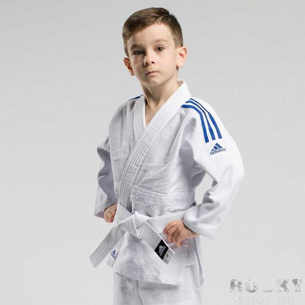Детское кимоно для дзюдо с поясом Club, белое с черными полосками AdidasЭкипировка для Дзюдо<br>Кимоно для дзюдо подростковое adidas Club J350-BELT c белым поясом!Тренировочное кимоно для дзюдо adidas Club - это универсальное кимоно средней плотности весом 350 gs/m2. Сделано из смеси полиэстера и хлопка. Хлопковые волокна, укрепленные полиэфирными нитями, обладают повышенной прочностью и лучше выводят влагу. Таким образом, кимоно дольше служит. Подходит, как для детей, так и для подростков. Состав ткани: 60% хлопок, 40% полиэстер. Детали: брюки на резинке+кулиска. Белый пояс в комплекте. Тренировочное кимоноПлотная, гибкая и прочная ткань. Плотность 350 gm/m2Усиленные места в областях с высокой нагрузкой. Пояс на штанах на резинке +кулиска. Три черных полоски на плечахМатериал: 60% хлопок, 40% полиэстер<br><br>Размер: 130 см
