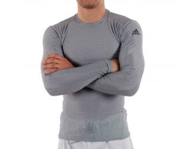 Футболка компрессионная (Рашгард) Rush Guard Long Sleeve, серая AdidasРашгарды<br>Рашгард с длинным рукавом, обеспечивает защиту от микротравм (ссадин, ожогов о мат), удобно сидит, практически не ощущаете его на теле как вторая кожа благодаря этому тело не остывает, что позволяет предотвращать мелкие травмы. Специальный материал обеспечивает циркуляцию воздуха, рашгард быстро сушится и достаточно прочный. Взято на вооружение многими видами единоборств!<br><br>Размер INT: S