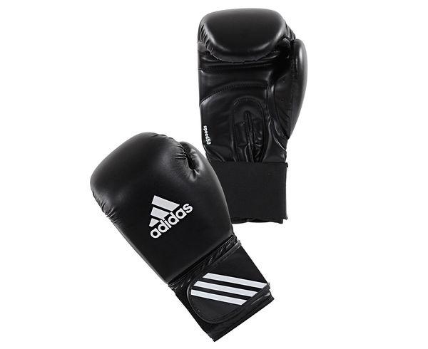 Перчатки боксерские Speed 50 черные, 12 унций AdidasБоксерские перчатки<br>Перчатки боксерские adidas Speed 50, разработаны на фундаменте технологий и высокого качества adidas, эти перчатки изготовлены из полиуретана 3 поколения по технологии PU3G INNOVATION. PU3G - это инновационный полиуретан нового поколения, который выглядит, как кожа, мягкий и прочный, и нечувствителен к колебаниям температуры и влажности. Подтверждено испытаниями. Инновационная Speed 50 перчатка состоит из многослойного, полностью литого блока пены до запястья. Это уникальная концепция, была запатентовано компанией adidas и в впервые было применено в производстве боксерских перчаток. Уникальность этой технологии заключается в том, что из нескольких слоев высококачественной пены высокого давления IMF (Intelligent Mould Foam Technology), которые склеены друг с другом, а затем вручную придается форма перчатки. Это дает боксеру небывалое ранее удобство в посадке перчатки на руку и легкость в тренировке,которые обеспечивают необходимую быстроту и скорость в нанесение удара, а так же оптимальный уровень безопасности партнеру во время тренировок. Новая система липучки с ремешком-Up Технологией ®: для быстрой и точной регулировкой боксерских перчаток. Состав: 100% полиуретан. Инновационная технология adidas SPEED®Технология PU3GINNOVATION®Технология I-Protech ®ТехнологияStrap-UP®Ширина манжета 7. 5 см. 100% полиуретан.<br><br>Цвет: черные
