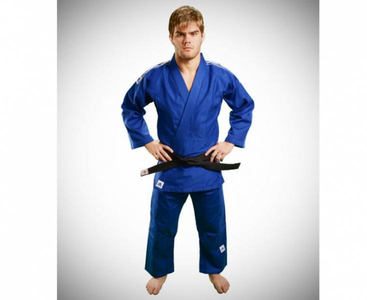 Кимоно для дзюдо Training синее, 170 см AdidasЭкипировка для Дзюдо<br>Тренировочное кимоно для дзюдо adidas Training J500. Универсальное кимоно средней плотности весом 500 gs/m2. Сделано из смеси полиэстера и хлопка. Хлопковые волокна, укрепленные полиэфирными нитями, обладают повышенной прочностью и лучше выводят влагу. Таким образом, кимоно дольше служит. Training подходит как для начинающих спортсменов, так и для мастеров. Состав ткани: 60% хлопок, 40% полиэстер. Детали: брюки на резинке+кулиска.   *Кимоно идет без пояса. Пояс продается отдельно.   Тренировочное кимоно.   Плотная, гибкая и прочная ткань.  Специально усиленные места в областях с высокой нагрузкой  Плотность: 500g/m2  Материал: 60% хлопок, 40% полиэстр<br><br>Цвет: синее