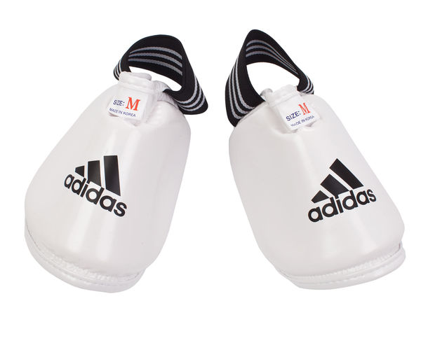 Защита подъема стопы для тхэквондо WTF Instep Guard, белая AdidasЗащита тела<br>Защита стопы для тхэквондо WTF и других единоборств. Материал: полиуретан.<br><br>Размер: XS