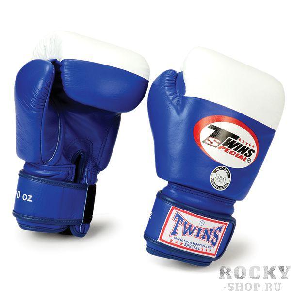 Перчатки для тайского бокса Twins Special, 10 унций Twins SpecialЭкипировка для тайского бокса<br>Перчатки BGVL-2Если вы ищите перчатки для соревнований хорошего качества, но по приемлемой цене, то модель Twins BGVL-2 в этом случае оптимальным решением. Ее вес может быть 10, 12, 14 унций, что гарантирует наибольшую скорость и интенсивность ударов бойца и минимизируют его утомляемость. Кроме того, в таких перчатках гораздо проще пробить защиту противника, удар в них более концентрированный. Дизайн перчаток целиком соответствует спортивным правилам, они бывают исключительно красные, синие, черные с белой ударной поверхностью. Особенности перчаток BGVL-2Отличительными свойствами Twins BGVL-2 можно назвать:использование при пошиве исключительно 100% кожи наинаивысшего качества, что гарантирует хорошую износостойкость и долговечность перчаток;преимущественно ручное изготовление, что гарантирует высокое исполнение конечного изделия;применение наполнителя из прослоенной пены;надежную фиксацию большого пальца, в целях снижения вероятности ушибов, переломов и вывихов в бою;удобную застежку-липучку, позволяющую спортсмену самостоятельно одевать и снимать перчатки;крепкие и проверенные нити, которыми сшиты перчатки;оптимальную форму, спроектированную с помощью компьютерного моделирования и на основе опыта профессиональных тренеров и атлетов. Соревновательные перчатки Twins BGVL-2 постоянно можно купить в интернет-магазине боксерской экипировки «Рокки». У нас в наличии модели любых расцветок и размеров. Если требуется купить дешево первоклассные и функциональные перчатки, то Twins BGVL-2 — лучший выбор. Их невысокая стоимость обеспечивается прямыми договорами с производителем и оптимизированными транспортными расходами при доставке боксерского снаряжения из Таиланда. Кроме того, положительно на цену продаваемых у нас перчаток влияет невысокая стоимость ручного труда в азиатских странах, если сравнивать с производителями из Америки или Европы. <br> Материал – 100% кожа наивысшег
