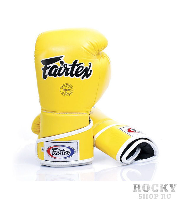 Перчатки для тайского бокса на липучке Fairtex, 12oz FairtexЭкипировка для тайского бокса<br>Трехслойная система защиты вокруг ударной части руки погашает удар и защищает от повреждений кисти. Увеличенный фиксация перчатки в области кисти для уменьшения риска получения травмы запястья. Сшитые из кожи класса  премиум.  Закрытый дизайн пальца перчаток STYLISH ANGULAR SPAR, чтобы снизить травмы глаза и большого пальца. Размер: 12 oz Цвет: черный, желтый.  Производство: Таиланд.<br><br>Цвет: Желтый