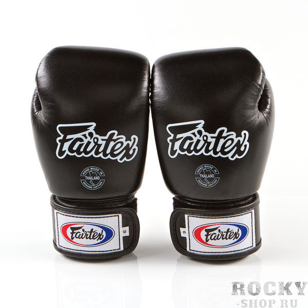 Перчатки для тайского бокса на липучке Fairtex, 14oz FairtexЭкипировка для тайского бокса<br>Перчатки BGV1 - универсальные модель, которая идеально подходит для Кикбоксинга, Бокса и Муай Тай. Прекрасно подойдут для тренировочных спаррингов, выступления на соревнованиях, работы на мешках и на лапах. Перчатки ручной работы, выполнены из натуральной кожи. Обладают хорошей амортизацией ударов за счет внутреннего наполнения пеной. Производство: Таиланд. Цвет: синий, красный, черный. Материал: кожа. Размер: 14 oz<br><br>Цвет: Синий