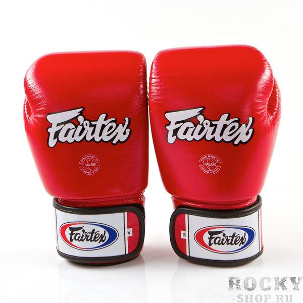 Перчатки для тайского бокса на липучке Fairtex, 8 oz FairtexЭкипировка для тайского бокса<br>Перчатки BGV1 - универсальные модель, которая идеально подходит для Кикбоксинга, Бокса и Муай Тай.Прекрасно подойдут для тренировочных спаррингов, выступления на соревнованиях, работы на мешках и на лапах.Перчатки ручной работы, выполнены из натуральной кожи.Обладают хорошей амортизацией ударов за счет внутреннего наполнения пеной.Производство: Таиланд.Цвет: синий, красный, черный.Материал: кожа.Размер: 8 oz<br>