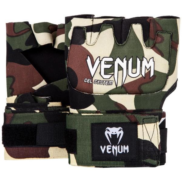 Гелевые бинты Venum Gel Kontact Forest Camo VenumБоксерские бинты<br>Классические гелевые бинты Venum Gel Kontact Forest Camo цвета камуфляж. Одобрены и активно используются многими топовыми бойцами мира единоборств. Их преимущество перед обычными бинтами - скорость одевания: пока остальные мотают первый бинт, Вы уже готовы к работе. Venum Gel Shock System обеспечивает превосходную защиту для рук, а также идеальную посадку на запястья. Обратите внимание, что данные перчатки можно использовать в лайтовых упражнениях на скоростной груше или грепплинге. Особенности:- состав: неопрен 70%, полиэстер 15%, каучуковый гель 10%, искуственная кожа 5%- 2,2 метра классической ленты для дополнительной фиксации запястьев- технология Venum гель Shock System ™ для идеальной амортизацииВнимание! Данный товар не подходит в качестве снарядных перчаток или перчаток для ММА.<br>
