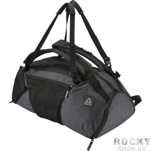 Сумка-рюкзак Reebok Combat Convertible Grip ReebokСпортивные сумки и рюкзаки<br>Сумка-рюкзак Reebok Combat Convertible Grip. Антибактериальная подкладка позволит не беспокоиться о запахе, а сетчатые вставки гарантируют вентиляцию. Регулируемые плечевые ремни. Мягкая задняя панель. Быстро превращается из обычной сумки в рюкзак. Расширяющиеся сетчатые карманы обеспечивают дополнительное хорошо вентилируемое место для хранения вещей. Габариты: 27 х 60 х 20, объем 42 л. Материал: 100% полиэстер.<br>