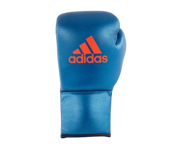Перчатки боксерские Glory Professional сине-оранжевые, 10 OZ XL AdidasБоксерские перчатки<br>Профессиональные боксерские перчатки adidas Glory Professional в расцветке коллекции SPEED. Перчатки adidas Glory Professional- это квинтэссенция качества, стиля, удобства, скорости и профессионализма, если вы хотите профессиональные перчатки, то вам нужны перчатки Glory Professional. Перчатки сделаны из 100% кожи высокого качества ручной работы. Glory Professional со шнуровкой, благодаря чему обеспечивается надежная фиксация кулака, снижается вероятность травмы, увеличивается жесткость удара. Усиленная защита большого пальца. Перчатки имеют отверстия на ладони, которые обеспечивает циркуляцию воздуха и влаги внутри перчатки и она быстро сохнет и остается свежей и таким образом имеет более длительный срок службы. Перчатки выполнены из композитного литого вкладыша из пены высокого давления IMF (Intelligent Mould Foam Technology) с сочетанием конского волоса, для придания оптимальной жесткости и консистенции ударной части боксерской перчатки, который так же обеспечивает однородный уровень поглощения удара, что гарантирует идеальную защиту для ваших рук. Это боксерские перчатки подходят для тех, кто ищет безопасную, комфортную и профессиональную перчатку, где качество на первом месте.Состав: 100% кожа высокого качества ручной работы.Профессиональные перчаткиОтличное сжатие кулака в перчатке.Топовая модель профессиональных боксерских перчаток в линейке adidasУсиленная защита большого пальцаКомпозитный литой вкладыш+конский волосМанжет на шнуровкеКожа высокого качества ручной работы.Дизайн и цвет коллекции SPEED.<br>