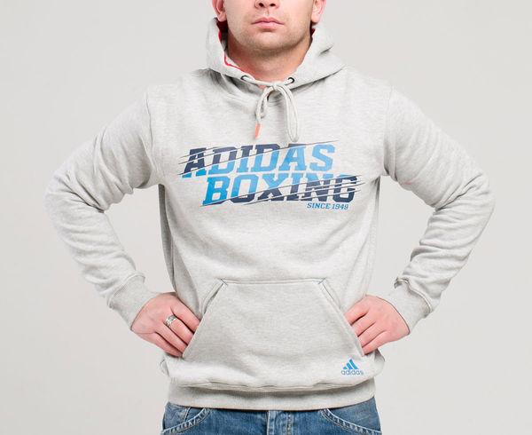 Толстовка с капюшоном (Худи) Graphic Hoody Boxing серая AdidasТолстовки / Олимпийки<br>Теплая толстовка с капюшоном, которая согреет во время тренировок в прохладную погоду. Эксклюзивная линейка COMBAT SPORT &amp;amp; MARTIAL ARTS. Разработанный adidas состав ткани, приятен на ощупь и прекрасно держит тепло. Свободный крой обеспечивает свободу движения при тренировке. В кармане кенгуру удобно хранить мелкие предметы. Высокая доля хлопка обеспечивает повышенную износостойкость материала. Логотип adidas boxing. Толстовку можно носить как на тренировках, так и в качестве повседневной одежды. Эксклюзивная линейка COMBAT SPORT &amp;amp; MARTIAL ART. Материал angeraut. Регулируемый капюшон со шнурком. Рифленые манжеты и нижний край. Крупная контрастная надпись adidas на лицевой стороне/ Карман кенгуру . Состав: 80% хлопок, 20% полиэстер<br><br>Размер INT: S