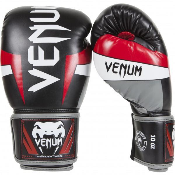 Перчатки боксерские Venum Elite Boxing Gloves - Black/Red/Grey, 10 унций VenumБоксерские перчатки<br>Стать элитой не так-то просто. Это результат напряженной работы, воспитание личности и достоинства. Так вот, боксерские перчаткиVenum Elite - ручная работа в Тайланде из 100% кожи Skintex. Трехслойная пена используется невероятно сбалансированного распределения ударной силы: бой за боем, Вы сможете повысить уровень ударной подготовки и свести к минимуму болевые ощущения. Специальные сетчатые панели на внутренней части перчаток в сочетании с эргономической формой принесут Вам максимальный комфорт во время тренировок и боя. Добавьте к этому усиленные швы, и Вы получите невероятный срок службы: будьте уверены, эти перчатки никогда Вас не подведут!Жесткие, долгие и правильные тренировки: ежедневная основа элитного бойца!Технические характеристики:премиумная синтетическая кожа Skintexспециальная сетчатая панель для оптимальной терморегуляциитрехслойная пена100% прилегание большого пальца для минимизации риска возникновения травмукрепленные швыбольшая эластичная застежка на липучкедлинные манжеты, улучшающие защиту запястьярельефный 3D логотип VenumТайланд, ручная работа<br>