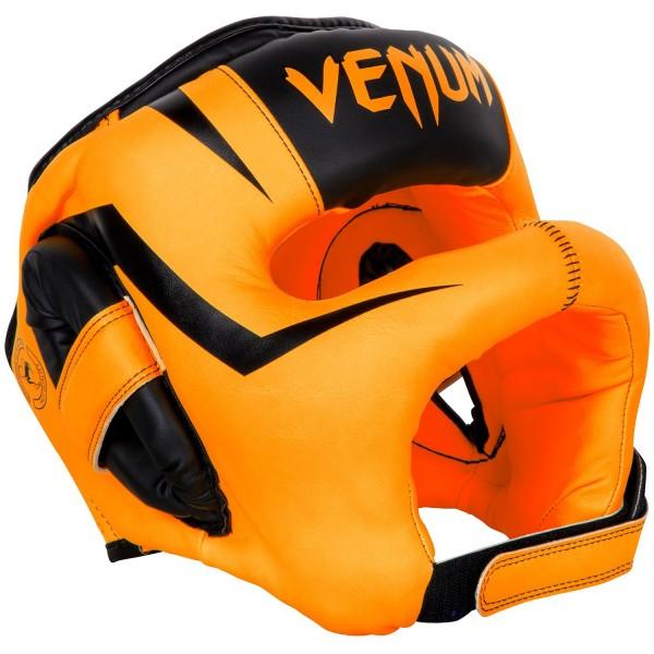 Шлем боксерский Venum Elite Iron Fluo Orange VenumБоксерские шлемы<br>Шлем боксерский Venum Elite Iron Fluo Orangeсоздан для тех, кто не хочет получать даже малейшие повреждения на лице.Бескомпромиссная защита обеспечивается в первую очередь за счет бампера, который сконструирован таким образом, что не позволяет ударам оппонента достигать Вашего лица.Многослойная внутренняя пена поглощает самые мощные удары.Идеальная подгонка по Вашей голове достигается специальным регулирующим шнурком и липучкой.Особенности:- синтетическая кожа высшего уровня Skintex- высокоплотная многослойная пена для оптимальной амортизации- шнурок для регулировки размера- застежка на липучке<br>