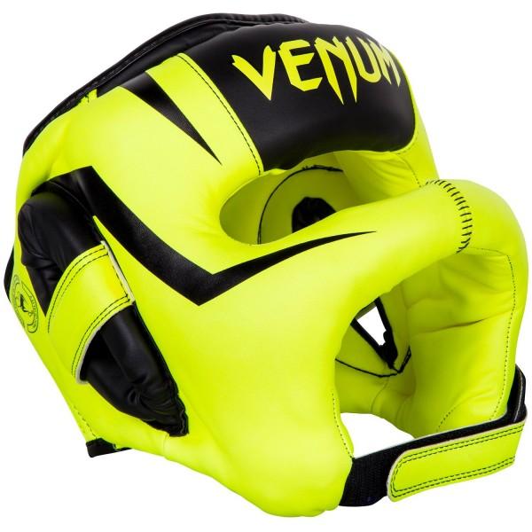 Шлем боксерский Venum Elite Iron Fluo Yellow VenumБоксерские шлемы<br>Шлем боксерский Venum Elite Iron FluoYellowсоздан для тех, кто не хочет получать даже малейшие повреждения на лице.Бескомпромиссная защита обеспечивается в первую очередь за счет бампера, который сконструирован таким образом, что не позволяет ударам оппонента достигать Вашего лица.Многослойная внутренняя пена поглощает самые мощные удары.Идеальная подгонка по Вашей голове достигается специальным регулирующим шнурком и липучкой.Особенности:- синтетическая кожа высшего уровня Skintex- высокоплотная многослойная пена для оптимальной амортизации- шнурок для регулировки размера- застежка на липучке<br>