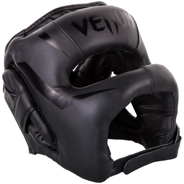 Шлем боксерский Venum Elite Iron Neo Black VenumБоксерские шлемы<br>Шлем боксерский Venum EliteIron Neo Black создан для тех, кто не хочет получать даже малейшие повреждения на лице. Бескомпромиссная защита обеспечивается в первую очередь за счет бампера, который сконструирован таким образом, что не позволяет ударам оппонента достигать Вашего лица. Многослойная внутренняя пена поглощает самые мощные удары. Идеальная подгонка по Вашей голове достигается специальным регулирующим шнурком и липучкой. Особенности:- синтетическая кожа высшего уровня Skintex- высокоплотная многослойная пена для оптимальной амортизации- шнурок для регулировки размера- застежка на липучке<br>