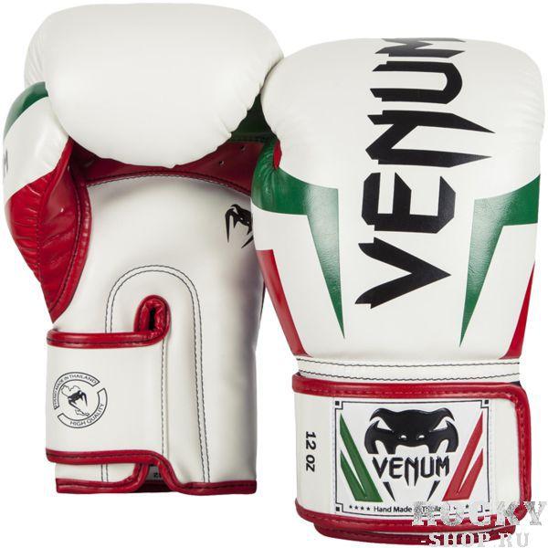 Боксерские перчатки Venum Italy, 14 oz VenumБоксерские перчатки<br>Боксерские перчатки Venum Italy. Классические перчатки для бокса, муай тай, ММА. Предназначены главным образом для работы в спаррингах. Очень хорошо сидят на руке. Широкая застежка обеспечивает надежную фиксацию перчаток Venum на запястье. Внутренний наполнитель - пена, которая обеспечивает хорошую амортизацию удара, а значит и обеспечивает хорошую защиту рук. Внешняя часть перчаток выполнена из материала Semi Leather. Очень качественно сделанные швы.<br>