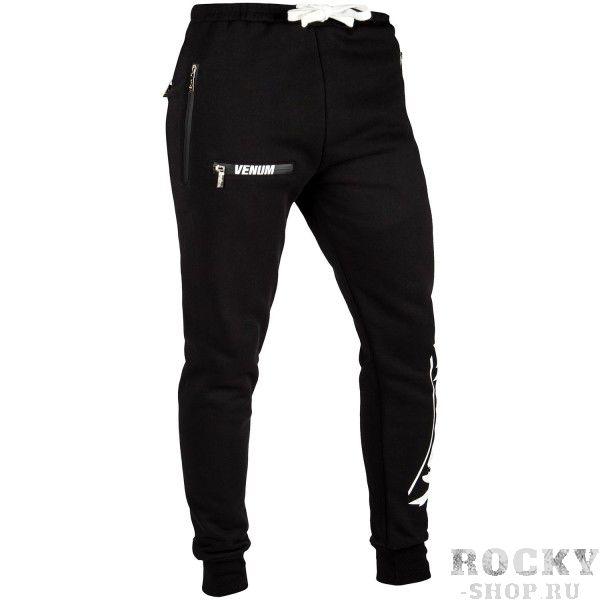 Брюки Venum Contender 2.0 - Black/White VenumСпортивные штаны и шорты<br>Брюки Venum Contender 2. 0 - Black/White - самые удобные спортивные брюки, которые Вы когда-либо носили. Идеальное сочетание хлопка и полиэстера делает их ултра-удобными. Внутренняя подкладка приятная к телу и гарантирует сохранение тепла тела. Спортивный крой обеспечит полный комфорт во время прогулок или бега. Два глубоких боковых кармана позволят хранить мелкие предметы. Носите их каждый день или тренируйтесь в них и получайте удовольствие от процесса!Особенности:- 80% хлопок/20% полиэстер- внутренняя подкладка- эластичный пояс со шнурком- боковые карманы- сделано в Китае<br><br>Размер INT: S