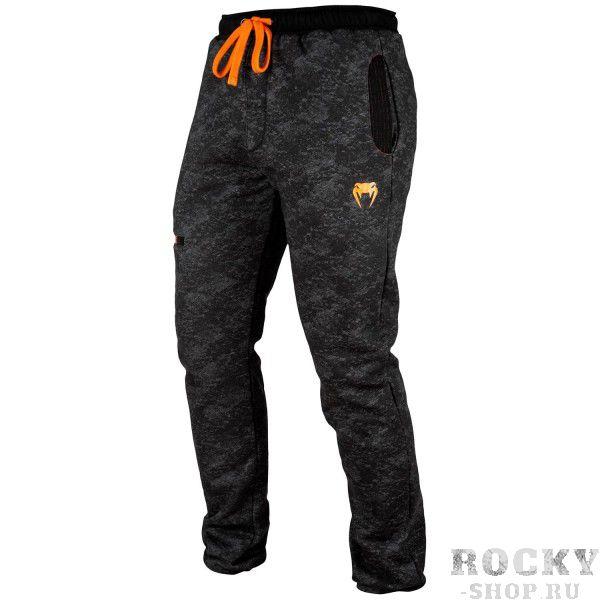 Брюки Venum Tramo - Black/Grey VenumСпортивные штаны и шорты<br>Брюки Venum Tramo - Black/Grey сочетают в себе комфорт и стиль с эффективной защитой от холода. Внутренняя подкладка позволяет сохранять тепло тела во время тренировок на открытом воздухе или в повседневной жизни. Оснащены шнурком для корректировки посадки на талии. Два боковых кармана и два кармана на молнии для хранения мелких предметов. Спортивный вид обеспечивает зауженный крой, а также смелый дизайн с использованием оранжевых тонов. Особенности:- 51% хлопок/49% полиэстер- внутренняя подкладка- эластичный пояс со шнурком- 2 глубоких кармана- 2 кармана на молнии- сделано в Китае<br><br>Размер INT: XXL