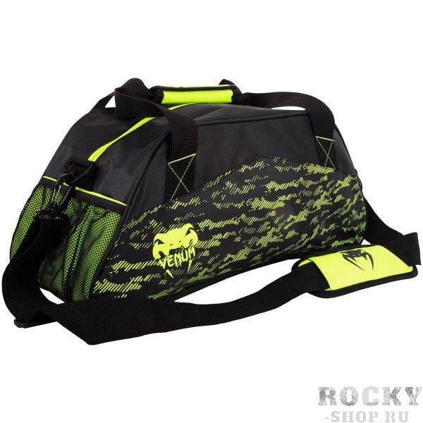 Сумка Venum Camoline - Black/Neo Yellow VenumСпортивные сумки и рюкзаки<br>Стильная, компактная и практичная сумкаVenum Camoline - Black/Neo Yellow позволит с комфортом переносить вещи на тренировку.Оснащена различными отделениями для хранения вещей.В комплект входит плечевой ремень.Особенности:- 100% полиэстер- молния- небольшие внутренние карманы + 2 сетчатых- ручки и плечевой ремень- размеры 48 х 20 х 21 см- сделано в Китае<br>