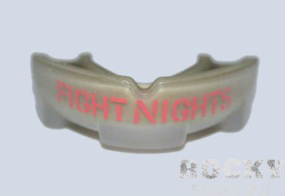 Капа Fight Nights Fight NightsБоксерские капы<br>Капа FN Team Капа – незаменимая вещь для любого спортсмена. Капа от бренда Fight Nights – идеально подойдет как занятий единоборствами, так и для любых видов спорта, где необходима максимальная защита спортсмена. Выполнена по специальной технологии, максимально предохраняющей ротовую полость, в то же время не мешает дыханию, не натирает десны, легка в применении. Изготовлена из прочной резины, поэтому прослужит вам долго.<br>