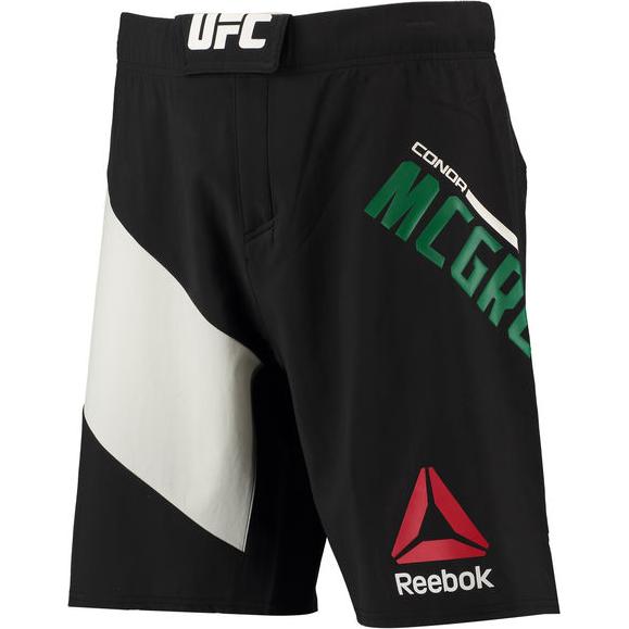 Шорты Reebok McGregor ReebokШорты ММА<br>Бойцовские шорты Reebok UFC Conor McGregor Octagon. Официальные шорты Конора The Notorious Макгрегора от Reebok UFC. Материал: полиэстер / эластан, тканый материал для эластичности, комфорта и полной свободы движений. Пояс на удобной застежке-липучке. Технология Speedwick эффективно отводит лишнюю влагу, обеспечивая сухость и комфорт. Разрезы по бокам и эластичная в 4-х направлениях ткань гарантируют полную свободу движений. Уход: машинная стирка в холодной воде, не отбеливать.<br><br>Размер INT: XL