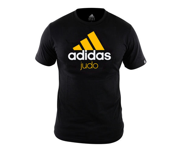 Футболка Community T-Shirt Judo черно-оранжевая AdidasФутболки / Майки / Поло<br>Стильнаяфутболкаиз эксклюзивной линейки adidasCOMBAT SPORT &amp; MARTIAL ARTS. Классика спортивного стиля, которая никогда не выходит из моды. Изготовленаиз ткани climalite®, которая эффективно отводит влагу от тела во время тренировки. На лицевой сторонекрупный контрастный логотип adidas и надпись JUDO. Удобный рифленый воротЭксклюзивная линейкаCOMBAT SPORT &amp; MARTIAL ARTSТкань сlimalite® отводит влагу с поверхности кожиРифленый круглый воротКлассический кройКрупный контрастный логотип adidas на лицевой сторонеНадпись JUDOСостав: 100% хлопок<br><br>Размер INT: M