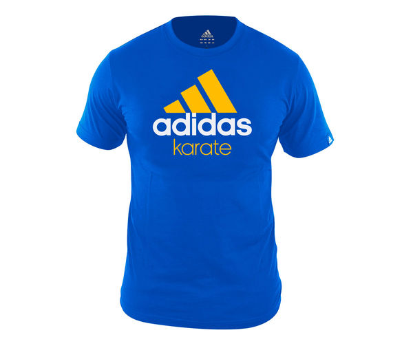 Футболка Community T-Shirt Karate сине-оранжевая AdidasФутболки<br>Стильная футболкаиз эксклюзивной линейкиCOMBAT SPORT &amp; MARTIAL ARTS. Классика спортивного стиля, которая никогда не выходит из моды. Изготовлена из ткани climalite®, которая эффективно отводит влагу от тела во время тренировки. Скрупным контрастным логотипом adidas на лицевой стороне и надписью KARATE. Удобный рифленый ворот. Тонкий хлопковый трикотаж. Эксклюзивная линейкаCOMBAT SPORT &amp; MARTIAL ARTSРифленый круглый воротТкань сlimalite® отводит влагу с поверхности кожиСостав: 100% хлопокКлассический кройКрупный контрастный логотип adidas на лицевой сторонеНадпись KARATE<br><br>Размер INT: M