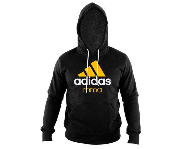 Толстовка с капюшоном (Худи) детская Community Hoody MMA Kids черно-оранжевая AdidasТолстовки / Олимпийки<br>Детская теплая толстовка с капюшоном, которая согреет во время тренировок в прохладную погоду. Эксклюзивная линейка COMBAT SPORT &amp; MARTIAL ARTS. Разработанный adidas состав ткани, приятен на ощупь и прекрасно держит тепло. Свободный крой обеспечиваетсвободудвижения при тренировке.  В кармане кенгуру удобно хранить мелкие предметы. Высокая доля хлопка обеспечивает повышенную износостойкость материала. Логотип adidas MMA. Толстовку можно носить как на тренировках, так и в качестве повседневной одежды. Эксклюзивная линейка COMBAT SPORT &amp; MARTIAL ART. Материал angeraut. Регулируемый капюшон со шнурком. Рифленые манжеты и нижний край. Крупная контрастная надпись adidas на лицевой стороне/Карман кенгуру . Состав: 80% хлопок, 20% полиэстер<br><br>Размер INT: рост 164 см