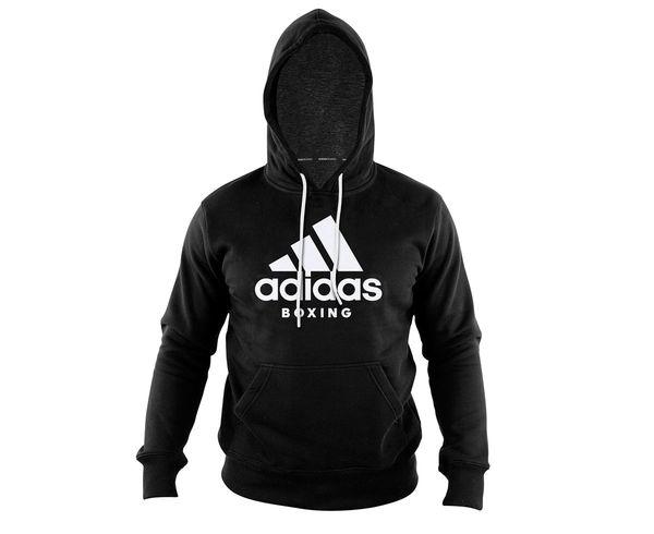 Толстовка с капюшоном (Худи) Community Hoody Boxing черно-белая AdidasТолстовки / Олимпийки<br>Теплая толстовка с капюшоном, которая согреет во время тренировок в прохладную погоду. Эксклюзивная линейка COMBAT SPORT &amp; MARTIAL ARTS. Разработанный adidas состав ткани, приятен на ощупь и прекрасно держит тепло. Свободный крой обеспечиваетсвободудвижения при тренировке.  В кармане кенгуру удобно хранить мелкие предметы. Высокая доля хлопка обеспечивает повышенную износостойкость материала. Логотип adidas и надпись BOXING. Толстовку можно носить как на тренировках, так и в качестве повседневной одежды. Эксклюзивная линейка COMBAT SPORT &amp; MARTIAL ART. Материал angeraut. Регулируемый капюшон со шнурком. Рифленые манжеты и нижний край. Крупная контрастная надпись adidas на лицевой сторонеКарман кенгуру . Состав: 80% хлопок, 20% полиэстер<br><br>Размер INT: 2XL