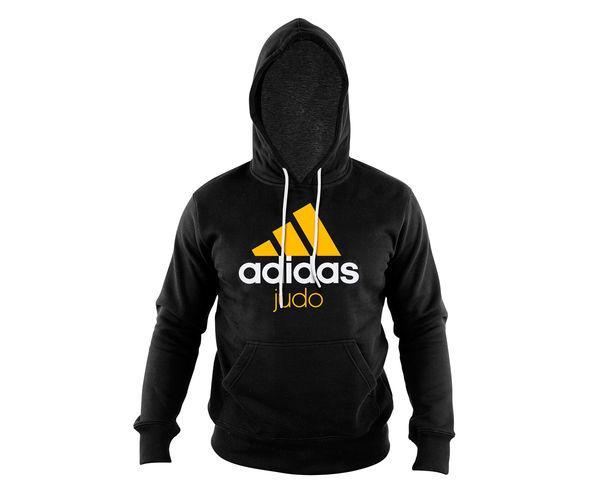 Толстовка с капюшоном (Худи) Community Hoody Judo черно-синяя AdidasТолстовки / Олимпийки<br>Теплая толстовка с капюшоном, которая согреет во время тренировок в прохладную погоду. Эксклюзивная линейка COMBAT SPORT &amp; MARTIAL ARTS. Разработанный adidas состав ткани, приятен на ощупь и прекрасно держит тепло. Свободный крой обеспечиваетсвободудвижения при тренировке.  В кармане кенгуру удобно хранить мелкие предметы. Высокая доля хлопка обеспечивает повышенную износостойкость материала. Логотип adidas JUDO Толстовку можно носить как на тренировках, так и в качестве повседневной одежды. Эксклюзивная линейка COMBAT SPORT &amp; MARTIAL ART. Материал angeraut. Регулируемый капюшон со шнурком. Рифленые манжеты и нижний край. Крупная контрастная надпись adidas JUDOКарман кенгуру . Состав: 80% хлопок, 20% полиэстер<br><br>Размер INT: XL