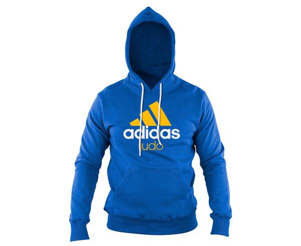 Толстовка с капюшоном (Худи) Community Hoody Judo сине-оранжевая AdidasТолстовки / Олимпийки<br>Теплая толстовка с капюшоном, которая согреет во время тренировок в прохладную погоду. Эксклюзивная линейка COMBAT SPORT &amp; MARTIAL ARTS. Разработанный adidas состав ткани, приятен на ощупь и прекрасно держит тепло. Свободный крой обеспечиваетсвободудвижения при тренировке.  В кармане кенгуру удобно хранить мелкие предметы. Высокая доля хлопка обеспечивает повышенную износостойкость материала. Логотип adidas JUDO Толстовку можно носить как на тренировках, так и в качестве повседневной одежды. Эксклюзивная линейка COMBAT SPORT &amp; MARTIAL ART. Материал angeraut. Регулируемый капюшон со шнурком. Рифленые манжеты и нижний край. Крупная контрастная надпись adidas JUDOКарман кенгуру . Состав: 80% хлопок, 20% полиэстер<br><br>Размер INT: M