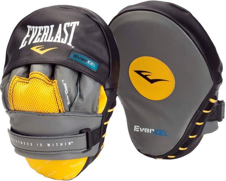 Лапы боксерские Everlast изогнутые Leather Evergel EverlastЛапы и макивары<br>Классические лапы в форме клешни богомола, Evergel Mantis Mitts предназначены для боксерских занятий спортом. Небольшая ударная поверхность позволяет отработать чувство времени и отточить скорость ударов. Лапы укреплены инновационной технологией EverGel™, что совместно с пенным наполнителем супер смягчает удары и защищает руки во в ходе занятий спортом. Качественная кожа гарантирует долговечность и износостойкость, проработанная защита пальцев - безопасность во в ходе занятий спортом, а комфортные застежки на липучках - удобство и жесткую фиксацию на руке. Продаются парой.<br>